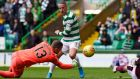 Celtic's Leigh Griffiths scores his side's first goal  during the cottish Premiership match against Hearts  at Celtic Park. Photograph: Ian Rutherford/PA Wire