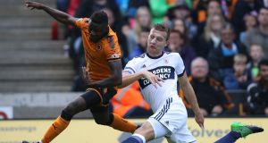 Middlesbrough's Ben Gibson (right) and Wolverhampton Wanderers' Bright Enobakhare battle for the ball during the Sky Bet Championship match at Molineux. Photograph:  Nick Potts/PA Wire