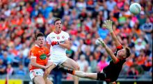 Tyrone's David Mulgrew scores his side's second goal despite the attempts  of  Niall Grimley and goalkeeper Blaine Hughes of Armagh during the  All-Ireland SFC quarter-final at Croke Park. Photograph: James Crombie/Inpho