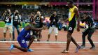Justin Gatlin bows down to Usain Bolt after the men's 100m final at the World Athletics Championships in London. Photo: Phil Noble/Reuters
