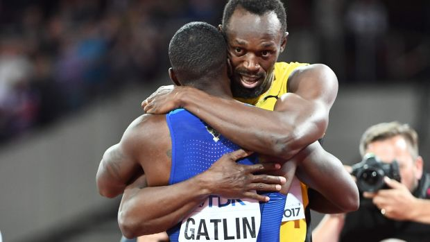 Bolt and Gatlin embrace after the race. Photo: Jewel Samad/Getty Images