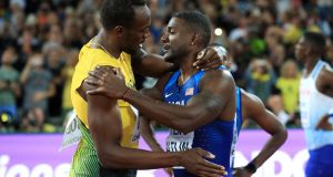 Usain Bolt and Justin Gatlin after the 100 metres final at the World Championships. Photograph: PA