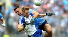 Dublin's James McCarthy and Kieran Hughes of Monaghan in action during the quarter-final  at Croke Park. Photograph: Ryan Byrne/Inpho