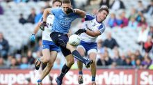 Dublin's Eoghan O'Gara is challenged by Monaghan's Dessie Mone at Croke Park.  Photograph: Ryan Byrne/Inpho