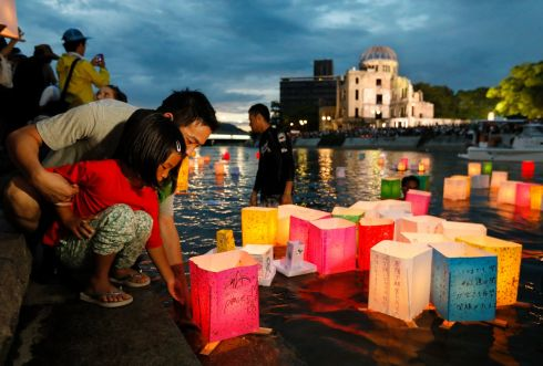 HIROSHIMA BOMBING: A girl floats a paper lantern to comfort the souls of victims of the August 1945 atomic bombing, at Hiroshima Peace Memorial Park, Japan. Photograph: Kimimasa Mayama/EPA