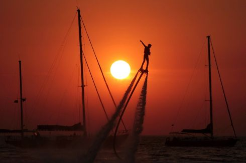 ON BOARD: A man practises flyboarding near the village of Olenevka, Crimea. Photograph: Pavel Rebrov/Reuters