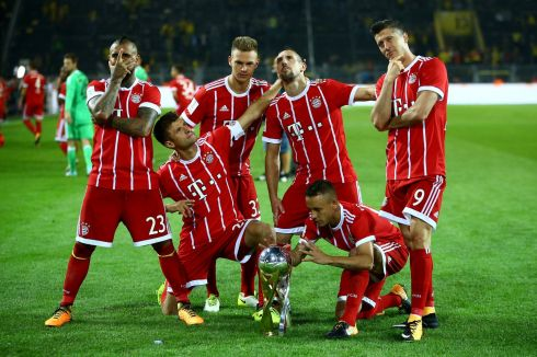 STRIKE A POSE: Bayern Munich players celebrate after beating Borussia Dortmund in the DFL-Supercup final, in Dortmund. Photograph: Wolfgang Rattay/Reuters