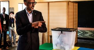 Incumbent Rwandan president Paul Kagame  arrives to cast his vote at a polling station in Kigali: has won a third term in power. Photograph:   Marco Longari/AFP/Getty Images