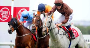 Dream Walker ridden by Chris Hayes (right) going  on to win  on the final day of the Galway festival. Photograph: PA Wire