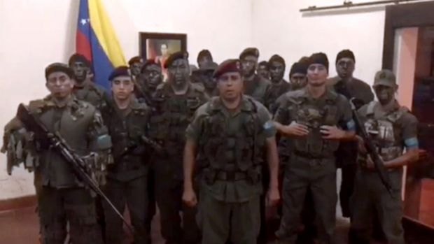 A TV grab taken from a video posted on social media of dissident military officials attempting an uprising at a barracks in Venezuela. Photograph: AFP/Getty Images