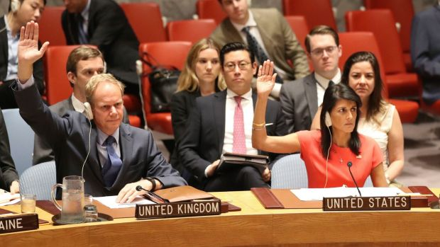 British Ambassador to the United Nations Matthew Rycroft and US Ambassador Nikki Haley vote during a Security Council meeting on North Korea. Photograph: Mary Altaffer/AP