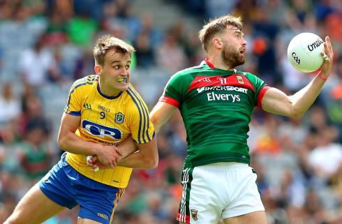 Roscommon's Enda Smith and Aidan O'Shea of Mayo in action. Photograph: James Crombie/Inpho