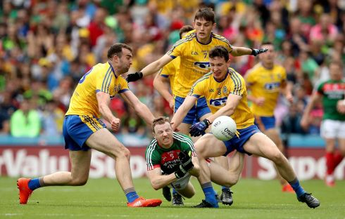 Roscommon's Caoileann Fitzmaurice and Seán Mullooly with Colm Boyle of Mayo. Photograph: Ryan Byrne/Inpho