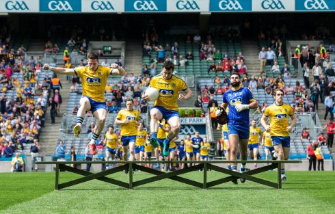 Roscommon's Ciarain Murtagh, Tadhg O'Rourke and Colm Lavin make their way for the team photo. Photograph: Oisín Keniry/Inpho