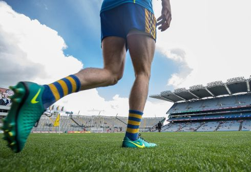 A Roscommon player tests the turf before the game. Photograph: Oisín Keniry/Inpho