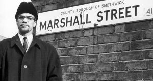 Malcolm X on Marshall Street in Smethwick during a visit to the Englishsh Midlands in 1965. He was assassinated nine days later on his return to the United States. Photograph: Getty Images