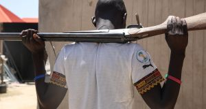 A Civilian Joint Task Force  member: under-resourced, they seize weapons after victories against Boko Haram.