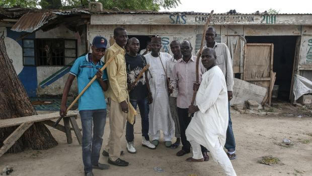 Members of Sector 10 of the Nigerian vigilante group Civilian Joint Task Force with weapons they use when accompanying the military.