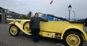 "Author John Jefferies with the Rolls Royce ""Moon Car"" on Cobh Pier at the launch of ""Death on the Pier"". Mr Jefferies is a descendant of one of the episode's key participants, IRA man Daniel ""Sandow"" O'Donovan"