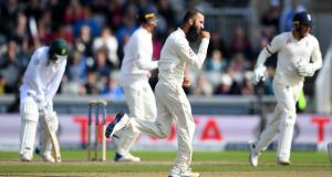 England spinner Moeen Ali celebrates taking the wicket of  South Africa's Quinton de Kock during   day four of the fourth  Test at Old Trafford. Photograph: Gareth Copley/Getty Images