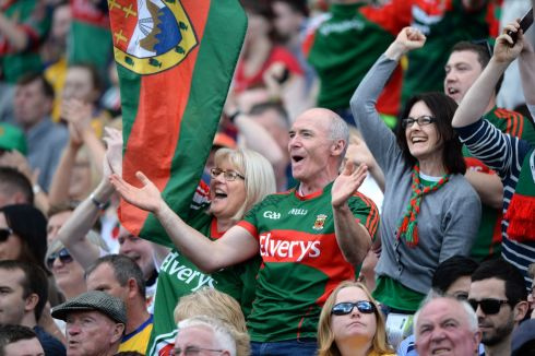 SHOW OF SUPPORT: Mayo fans celebrate their team's win over Roscommon in the All-Ireland senior football championship quarter-final replay at Croke Park. Photograph: Dara Mac Dónaill/The Irish Times