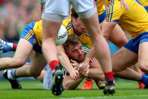 GROUND CONTROL: Roscommon's David Murray and Mayo's Aidan O'Shea during the All-Ireland senior football championship quarter-final replay at Croke Park. Photograph: INPHO/James Crombie