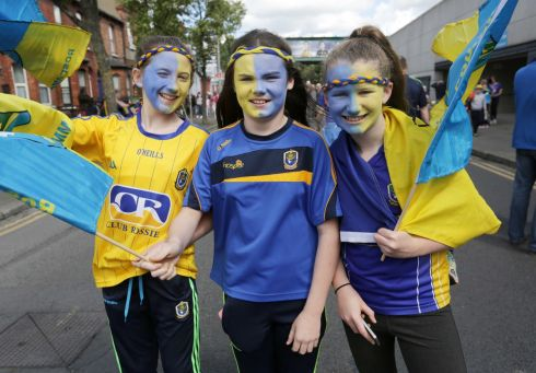 FAN ART: Ellen Ryan, Emma Hough and Kate Harlow on their way to Croke Park for the All-Ireland senior football championship quarter-final replay. Photograph: Laura Hutton/Collins Photo Agency