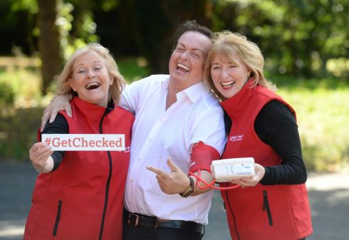 HEART OF GOLD: Marty Morrissey helps Mary Rose Jordan and Marese Damery mark the anniversary of Irish Heart's Mobile Health Unit, at Herbert Park, Dublin. Photograph: Dara Mac Dónaill/The Irish Times