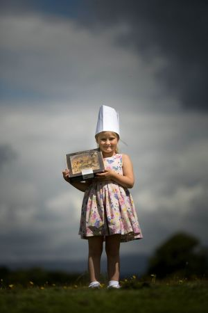 FOOD FIGHT: Little chef Elizabeth Jezkova with a Masterchefs Hospitality quiche, after it achieved three gold stars at this year's Great Taste Awards. Photograph: Sean Curtin/True Media