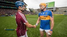 Galway's Johnny Coen shakes hands with Tipperary captain Pádraic  Maher  after the game. Photograph: Ryan Byrne/Inpho