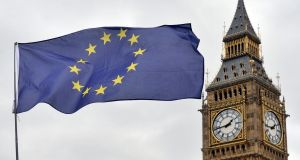 An EU flag flys in front of the Houses of Parliament in London. Photograph: Victoria Jones/PA Wire