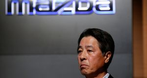 Mazda Motor President Masamichi Kogai announces the firm's major breakthrough in engine technology
