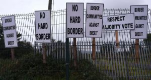 A protest by anti-Brexit campaigners at the Border town of Carrickcarnon, Co Louth.   Photograph: Reuters/Clodagh Kilcoyne
