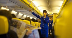 Safety instructions shown by a stewardess on  a Ryanair flight. File photograph:  Getty