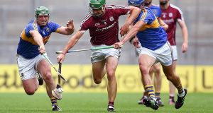 Galway's David Burke in action against Tipperary's John O'Dwyer and John McGrath. Photograph: Tommy Grealy/Inpho