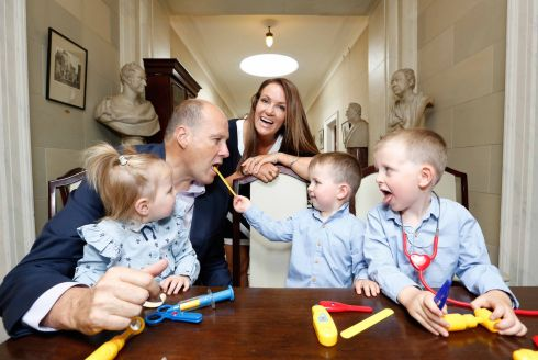 SAY AHH: Co-hosts Ivan Yates and Dr Ciara Kelly with Ella (2), Calum (3) and Josh (4) Morrisey (all from Kilkenny), launching the National Association of General Practitioners (NAGP) Gala Charity Ball at the RDS, Dublin. Photograph: Sasko Lazarov/Photocall Ireland