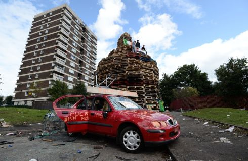 BURNING TENSIONS: The bonfire in the New Lodge area of Belfast as police call for calm after cars and a disused building were set on fire during disorder in the city on Monday night. Photograph: Pacemaker