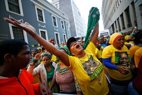 ZUMA SURVIVES: Supporters of the president in Cape Town cheer as Jacob Zuma survives a vote of no confidence in South Africa. Photograph: Mike Hutchings/Reuters