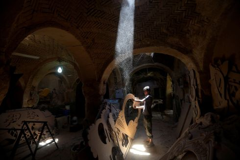 CRAFTSMAN: A man builds a traditional boat in Najaf, Iraq. Photograph: Alaa Al-Marjani/Reuters