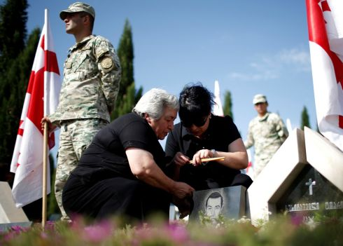 SOUTH OSSETIA: Relatives of the Georgian soldiers killed during the war with Russia over the breakaway region of South Ossetia in 2008 mourn during a ceremony at the memorial cemetery in Tbilisi, Georgia. Photograph: David Mdzinarishvili/Reuters