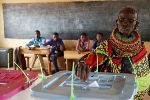 HAVING THEIR SAY: A Turkana tribeswoman casts her ballot at a polling station during the election in a village near Baragoy, Kenya. Photograph: Goran Tomasevic/Reuters