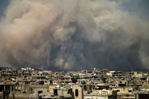 SYRIA: Smoke billows following a reported air strike on a rebel-held area in the southern Syrian city of Daraa. Photograph: Mohamad Abazeed/AFP/Getty Images