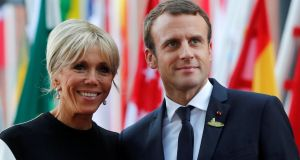 Brigitte  and Emmanuel Macron: Ms Macron is waiting for her situation to be clarified, as her husband promised during his presidential campaign. Photograph: Wolfgang Rattay/Reuters