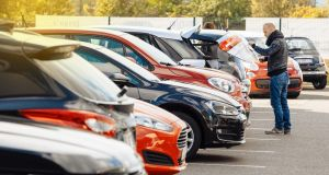 The average cost of running a family car for a year has fallen due to a drop in motor insurance premiums.