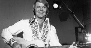 Rhinestone Cowboy-era Glen Campbell shot taken in his 1970s heyday. File photograph: Getty Images