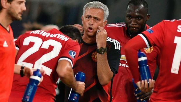 Jose Mourinho during one of two water breaks taken in Sweltering conditions in Skopje. Photograph: Nikolay Doychinov/AFP