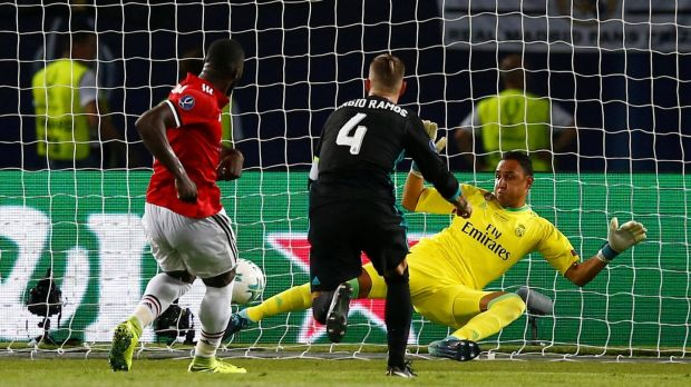 Romelu Lukaku scores for Manchester United in their Super Cup defeat to Real Madrid. Photograph: Peter Cziborra/Reuters