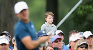 Fans look on as Brooks Koepka hits a shot during a practice round prior to the US PGA Championship at Quail Hollow, Charlotte, North Carolina. Photo: Warren Little/Getty Images