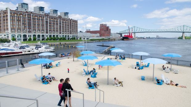 The city has several artificial beaches including this one at the Montreal clock tower with the Molson brewing company and Jacques-Cartier Bridge in the background. Photograph: Getty Images