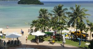 Tourists on a beach in Guam's capital, Hagatna. Photograph:  Mar-Vic Cagurangan/AFP/Getty Images